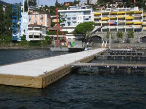 Aufbau, Aufstellung und Verankerung eines 60 m langen und 120 t schweren Wellenbrechers in Ascona