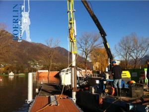 Posa nuovo pontile per il Centro Sportivo Nazionale di Tenero, con infissione di 2 pali (lung. 12 m). Tenero, Lago Maggiore.