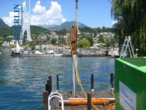 Infissione nel fondale di 6 pali di fondazione (10 m x 30 cm) per pontile, Ascona.