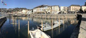 Ascona, sostituzione pali di ormeggio nei porti comunali. Infissione di 80 pali e taglio subacqueo dei vecchi pali.
